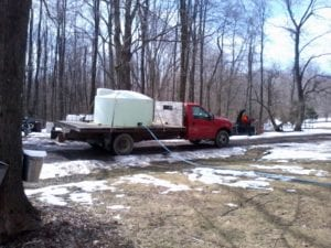 picture of us collecting maple sap onto our truck